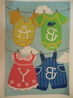 baby overalls and dresses on clothesline girl
