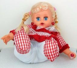 Laughing Sitting Girl Baby Doll in Red Dress Plush Plastic -